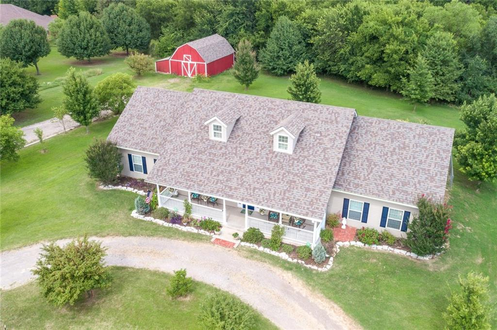 *CLOSING COST Negotiable W/FULL PRICE OFFER* NEW 8/28/19 This charming Cape Cod-style home is nestled on 3.33 acres & is one of only two homes on Lewis Lane! Outstanding curb appeal & charm will welcome you w/the oversized front porch. Featuring 4 HUGE bedrooms+ LG Study, 2.5-baths & 2 Car Garage! Incredibly strong & energy efficient, this house is constructed of structurally insulated panels (SIPS) & has been tested to withstand winds up to 180 mph! You will love the bright & airy feel throughout the entire space. Beautiful hardwood floors cover the majority of the space & custom knotty alder woodwork detail adds even more charm & character. There is plenty of space for entertaining year-round in the gorgeous kitchen, formal dining & living rooms, spacious four seasons sunroom & bonus loft space! Unwind in the beautiful master bath boasting double vanities, Walk-in shower & Jacuzzi Tub! Conveniently near I-35, this peaceful country lifestyle right in the middle of the city awaits!