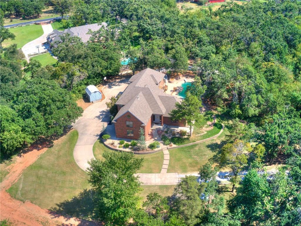 This custom-built, one-owner home, on 2.61 acres, is in the coveted Oakdale school district. In a fantastic location, this structure was built into the side of a hill and nestles into the trees of this private, wooded lot. A plethora of windows throughout provides for sunlit rooms and gorgeous views. An open kitchen/living room area looks out to the beautiful pool with waterfall. A large room near the living area can be used as a gameroom or hobby room & above the living room is a loft that can be used as a study or additional living space. The master bedroom suite is downstairs & 4 beds are up. 2 of the bedrooms share a unique loft/play space, designed to foster childhood adventures.  The 3rd bedroom is large, has a built-in desk with shelving & could alternatively be used as an office or 2nd master suite.  A self-sufficient apartment with kitchen, living, bedroom & full bath are upstairs and has a separate entrance. Generac generator. R52 insulation under roof R19 in walls.