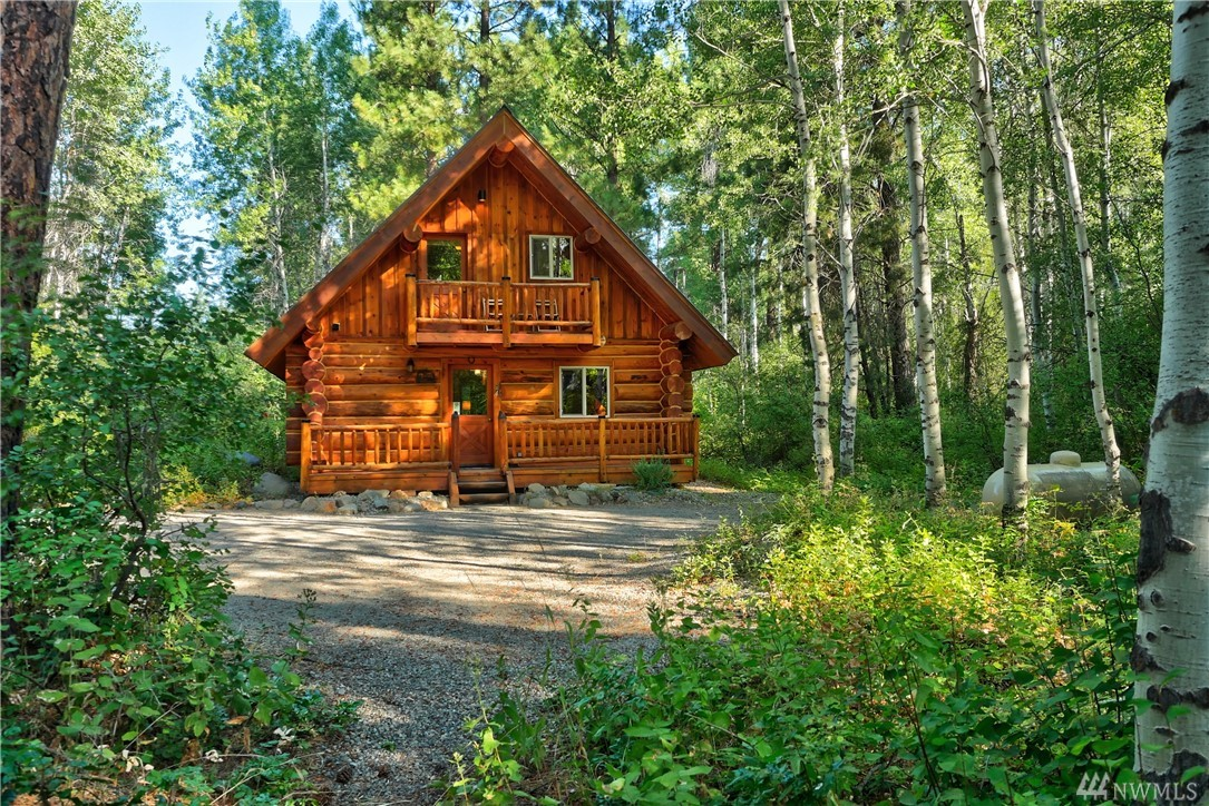 The perfect vacation retreat and popular nightly rental. Beautiful hand-scribed log cabin w/24-year rental history, repeat customers/excellent reviews. 1 bedroom + loft, sleeps 6. All within the private, tranquil setting of a pine & aspen forest. Log exterior is newly refinished. Free ski passes w/trail at the property corner. Private class B well, 2.2 deeded acres, 2 horse paddocks, plus access to Methow River, Wolf Ridge PD pool, hot tub & 40+acres shared open space. Includes most furnishings