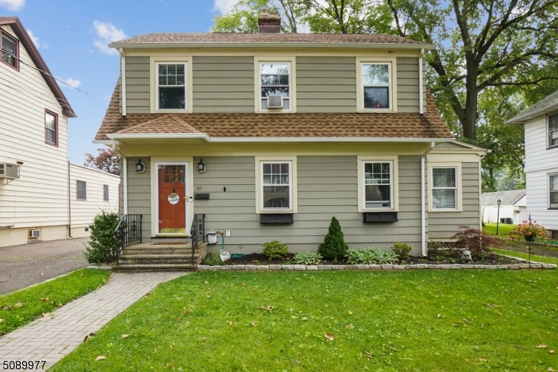 Move right into this Charming 3 bedroom, 2 bath Colonial rehabbed in 2014. New windows, roof, electrical service, rebuilt garage w/new roof, two bathrooms, kitchen w/granite, SS appliances and more. Main level is living room w/wood fireplace, dining room overlooking a large fenced in yard, kitchen, half bath and two French doors lead to a family room or home office.  Second floor is 3 bedrooms, full bath, walk up attic could be 4th bedroom or rec room. Recessed lighting and roomy clean basement awaits your finishing touches. Large lot shared driveway survey is available. Great neighborhood location with NYC bus at the corner, neighborhood park and a close proximity to schools. Hardwood floors throughout and lovely fenced in backyard with a beautiful grassy area and paver patio for entertaining.