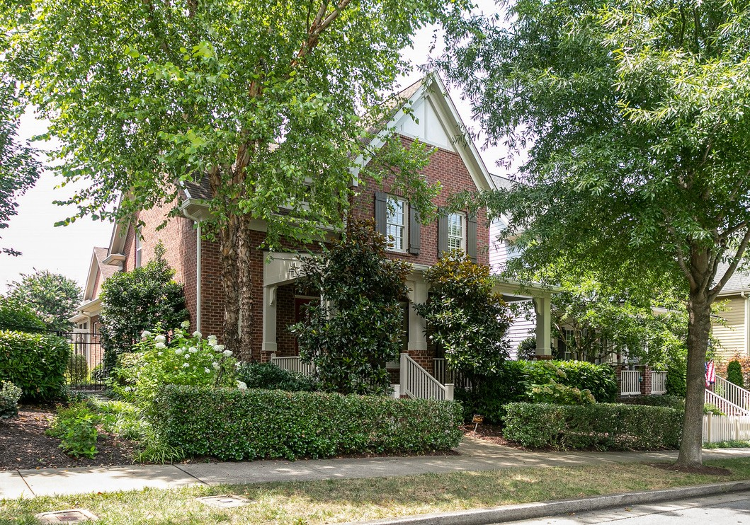 All brick 4 bedroom or 3 with bonus room. Great floor plan with huge front porch, updated kitchen and primary bath. Hardwoods on main level.  Beautiful screened in porch overlooking landscaped courtyard. Extra parking pad on driveway.  Just 3 houses down from the Resident's Center and an easy walk to the Town Center. Professional pictures coming July 26th. Showings start July 27.