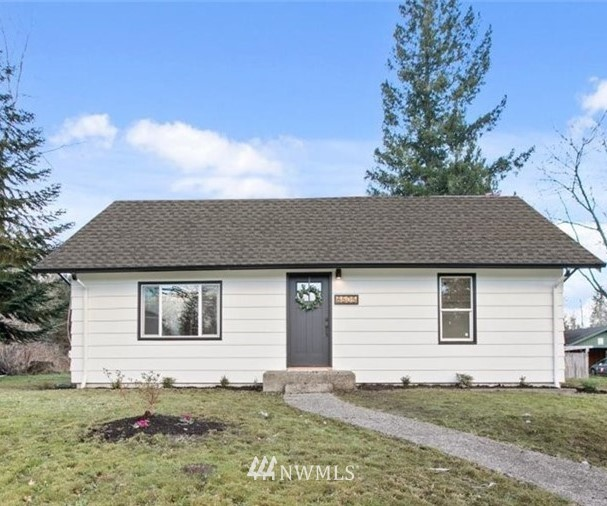 Don't miss this charming, completely updated home in historic downtown Snoqualmie! This home offers a brand new kitchen, large island, quartz countertops,  new ss appliances, subway tile and open wood shelving.  This amazing layout opens to a dining room and spacious family room. This home has been completely remodeled with new roof, windows, septic, interior and exterior paint, heaters, carpet and vinyl plank flooring. It is walking distance to downtown Snoqualmie, minutes to freeways yet situated on a large, secluded lot with views of Kimball Creek.