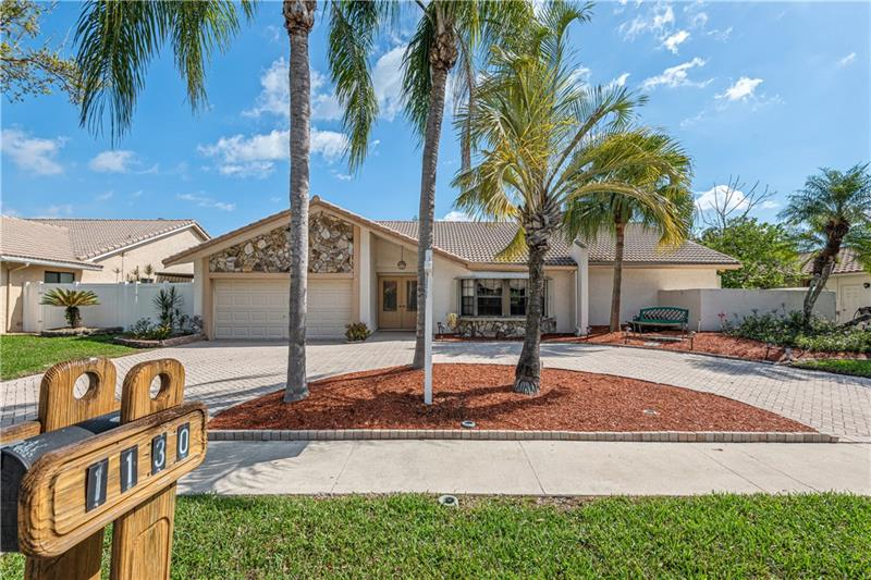 Pride of ownership is shown in this Jacaranda Lakes waterfront/pool home. This 4 BR, 2 Bath home is very spacious and bright. There is approximately 2476 square feet of living space and is easily identified by the lg. size of the rooms. The split BR plan offers a huge primary BR plus a sitting area w/vaulted and beams accenting the ceilings on the S. side of the home. A large sunken living room is in the front and to the rt. of the entry w/high vaulted ceilings accented by oak beams. The kitchen is open to the FR and has a wonderful pass-thru of sliding windows to the patio/pool making entertaining a breeze. The pool & lg. cool deck patio is covered by a dome screen enclosure keeping you safe from unwanted bugs/ducks. Enjoy this E/W exposure as you take in the wildlife along the canal.
