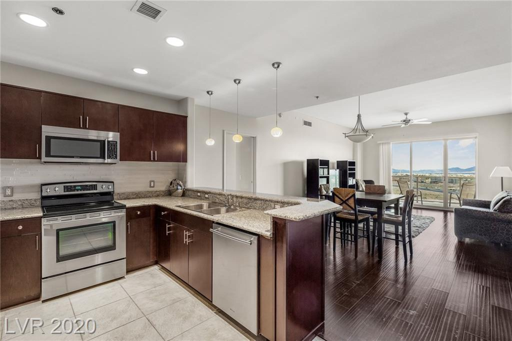 Strip and Mountain Views! This condo has a social calendar that you can't miss. 3 Events minimum monthly. Storage unit and covered parking space included. Completely remolded. New glass back splash and beautifully redone upgrades throughout. Jacuzzi tub and built in closets. Free coffee every morning in lobby. Fitness Center, free water, cable and internet!! 2 dog parks and amenities galore! Easy rental for extra income too!! MUST SEE!