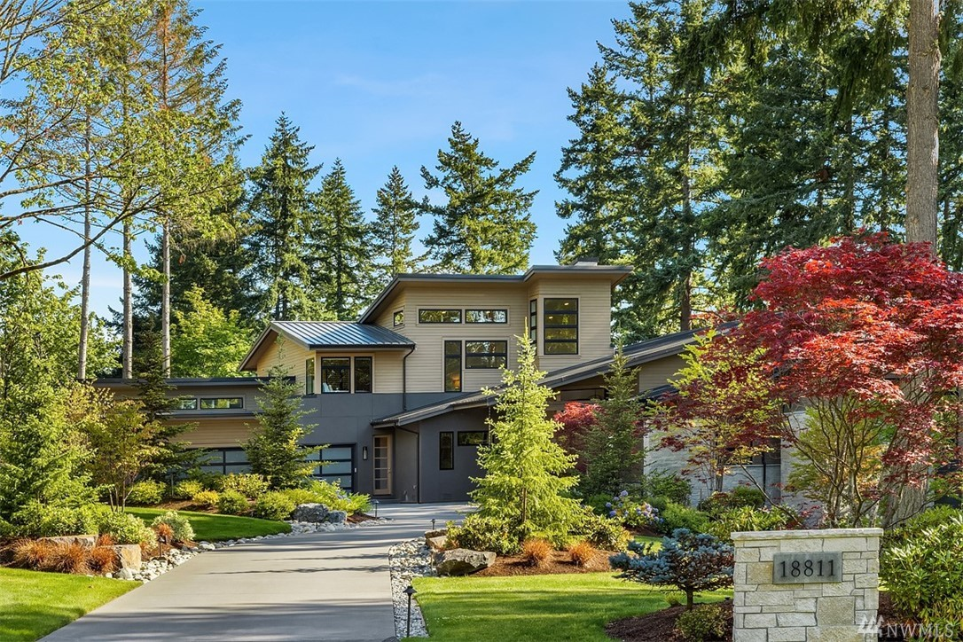 Peaceful setting for this stunning Burnstead built home set back on 3.7 private acres. Flooded with natural light & Lake Sammamish views, the entertainment sized kitchen opens to dining & family room w/12 ft Nana doors leading to the back deck. Master suite on the main floor, giant custom closet & spa like bath-w/ windows that frame the outdoors.  Lower level rec room, has walk in wine cellar, custom wood sauna & exercise room. Back patio with outdoor spa & firepit. Plans avail for Guest house.