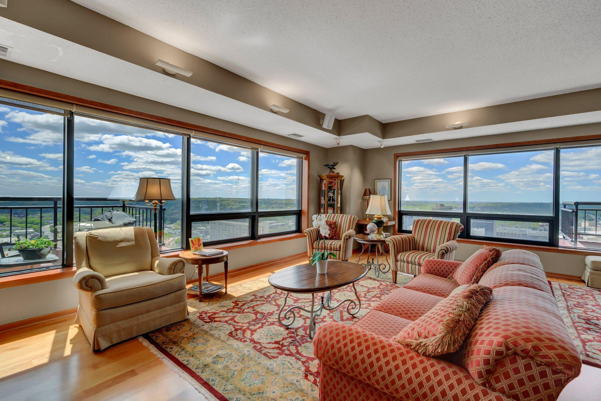 Spectacular skyline & river views up & down the Mississippi River. Great Lowertown location, on Mears Park & the skyway. 2 blocks to CHS Field & the Farmer's Market. Walk to restaurants, entertainment & the river trails. Wonder open floor plan is perfect for entertaining. Gorgeous custom kitchen was featured in a magazine, large dining & living spaces, floor to ceiling windows wrap 3 sides of the building & there are  3 balconies to enjoy panoramic views. Relaxing family is set away from the main living area, featuring a special nook with great views. Huge master suite with custom closet, large bath with separate tub & shower. You will love this amazing Lowertown home!