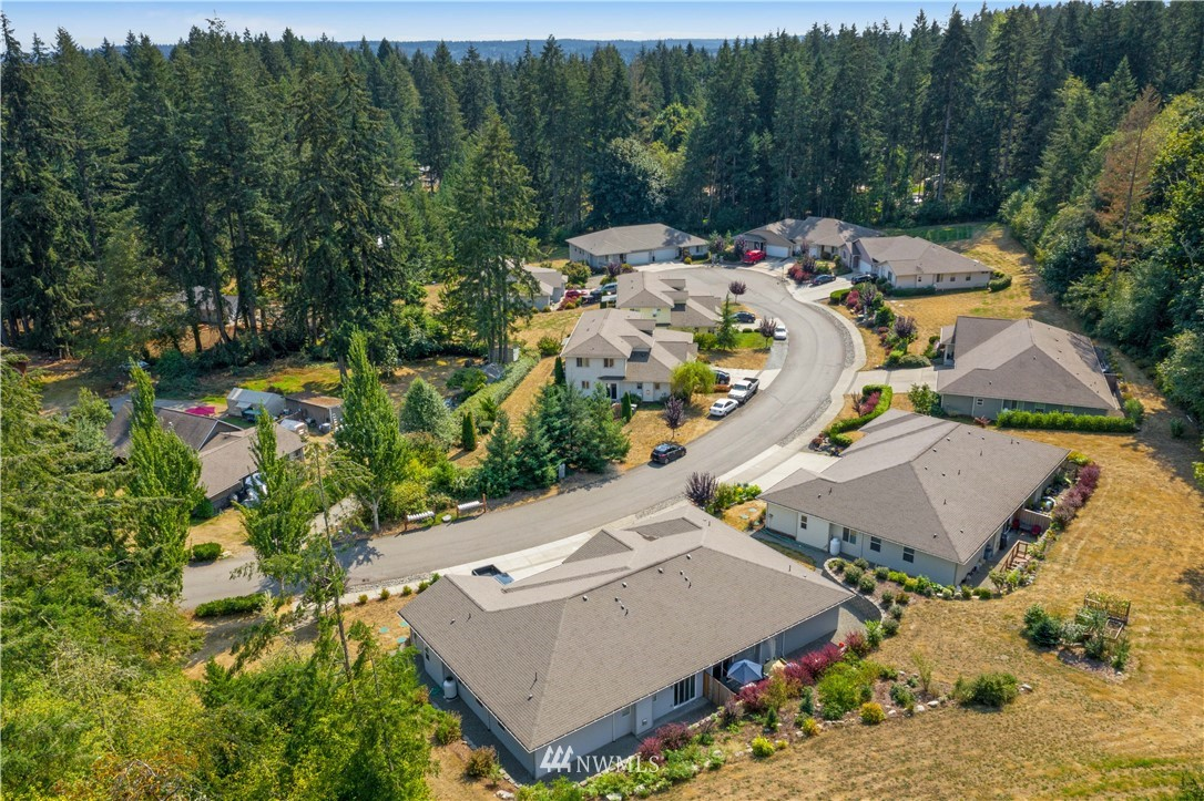 It's past time to invest in Gig Harbor! Pride of ownership is evident in this established neighborhood with 7 duplexes + single family home. Beautiful setting with lots of green space, located minutes from shopping/schools/hospital. Duplexes built between 2008-2016 and are professionally maintained. Unit breakdown in listing is a sample; sq ft range from 1401-1690. All units have main floor master suites. SFR was existing on the parent parcel and has separate access off of Hwy 302.