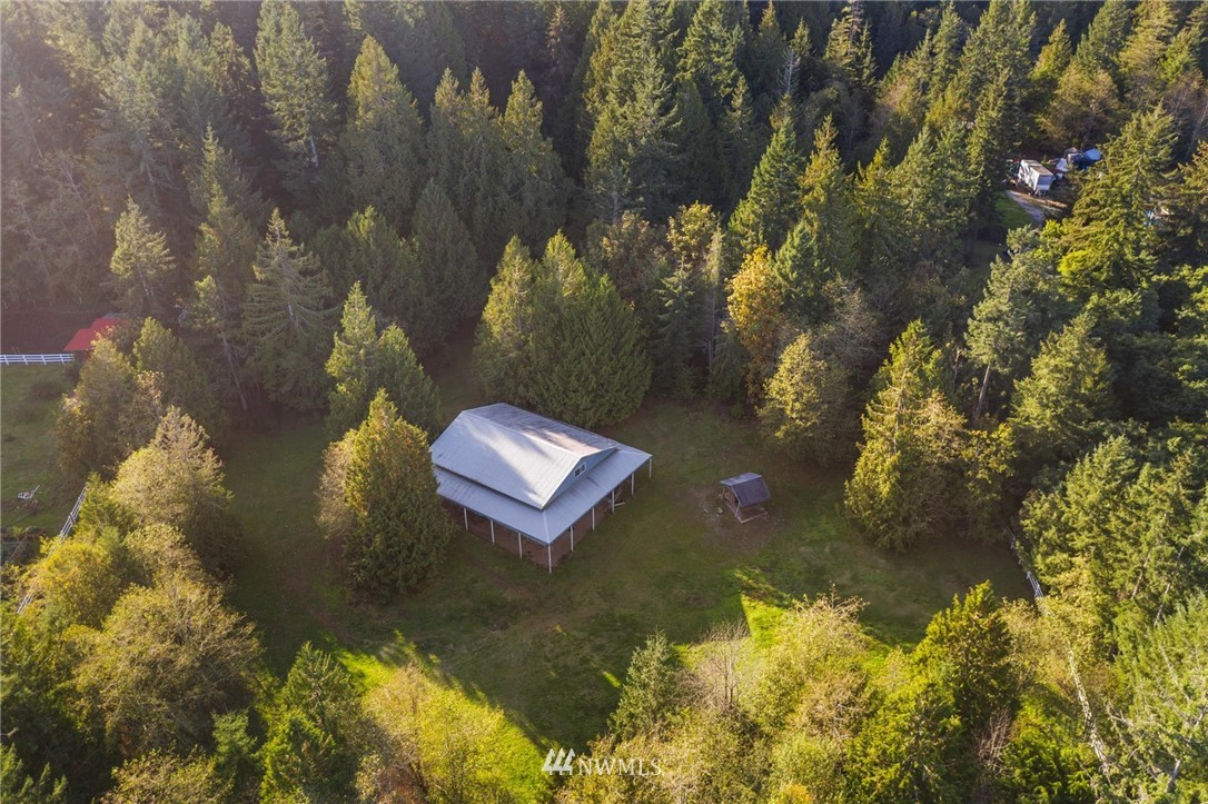 Stop the truck, finally a horse ready property! Unbelievable opportunity nestled in the woods just off Olympic View, perfectly situated on 2.47ac you'll find a well built, 5+ stall barn w/tack & feed rooms, storage area or make addt'l stalls. Expansive overhang around entire barn. Each stall equipped w/dutch style doors & premier stall fronts. 2nd story for temporary living space while you build your dream home?? or hay storage when you buy the adjoining home. Rolling/level land w/well drilled!
