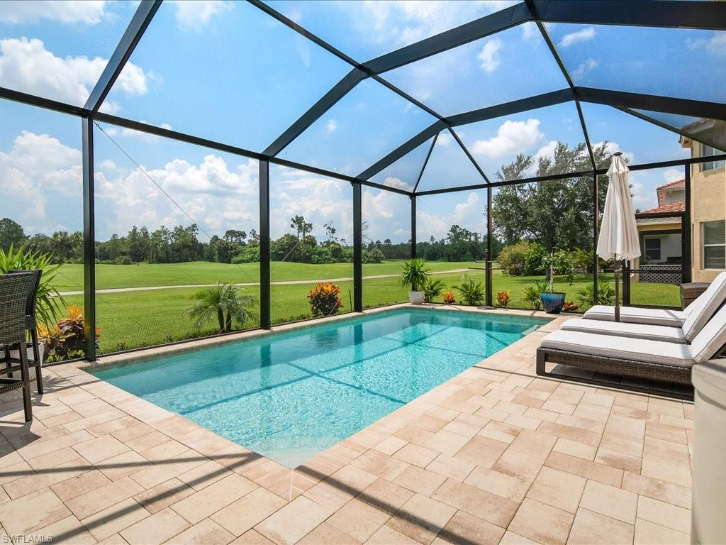 5 bedroom plus loft/den and featuring a BRAND NEW POOL! Shows beautifully and represents a solid value in today's market.  Separate living room, great room, and generous kitchen open to large family room.  Eat-in kitchen area with breakfast bar and separate dining area.  The oversized master retreat features a French door entry, two walk-in closets plus a large master bathroom with tub, shower, and two separate vanities and water closets.  The new heated pool features color-changing LED lighting.  New pool cage with large screen panels creates an open feeling to showcase the panoramic golf course views.  There is also a built-in BBQ grill and refrigerator.  Ideal location within the community and walking distance to the clubhouse which offers a resort style pool, fitness center, billiards room, card/library/meeting room, kitchen and on-site manager.  The golf course is pay-as-you-play and private golf carts are allowed.  The LOW HOA FEE includes lawn care, irrigation and security alarm monitoring.  Growing area close to schools, shopping, new County park and Founders Square - both under construction.  Stop searching and start living the Naples lifestyle you deserve this summer!