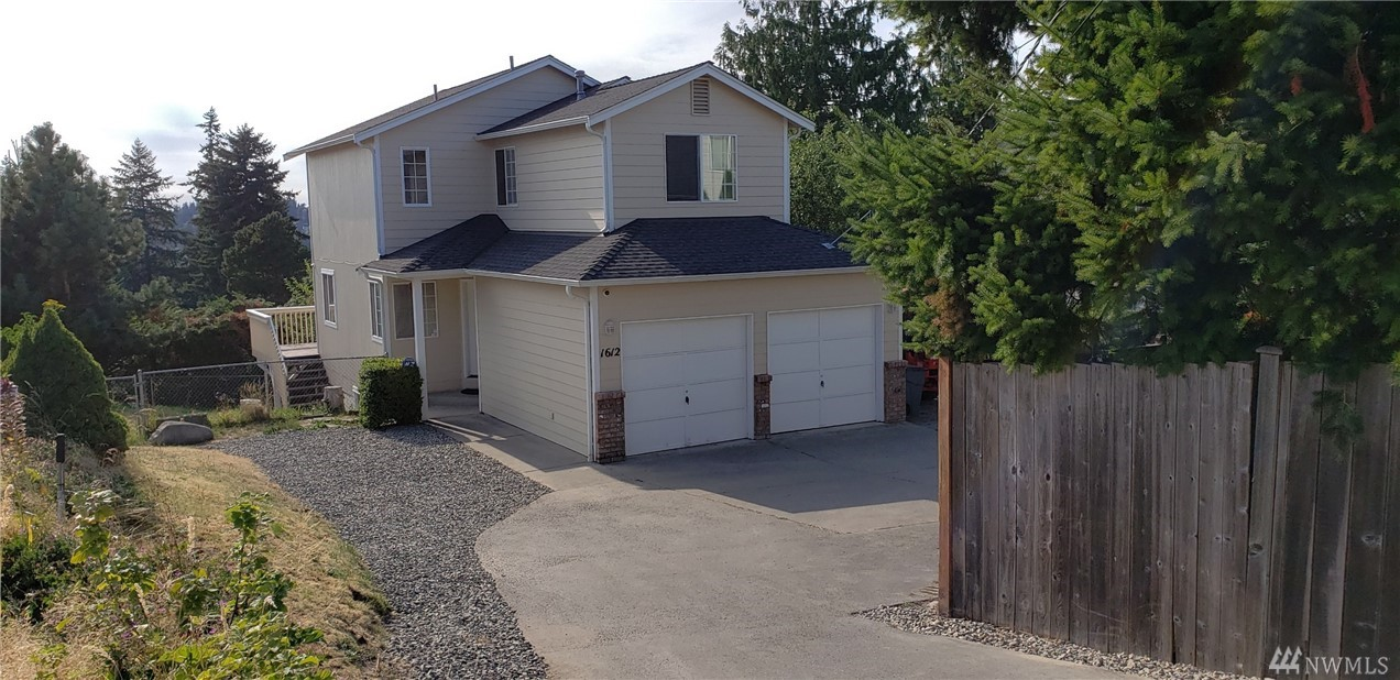 Expanded parking just completed. Great home at end of private road. Large deck with 180 degree view, 2 car garage and RV parking. Main floor features living/dining room combination with view to the West, well appointed kitchen, white cabinetry and new countertops, utility room and half bathroom. Upper level with three bedrooms, master with full bath and walk-in closet. Lower level with family room, 4th bedroom and storage closet. Fife school district. Sellers trucks and trailers have been moved.