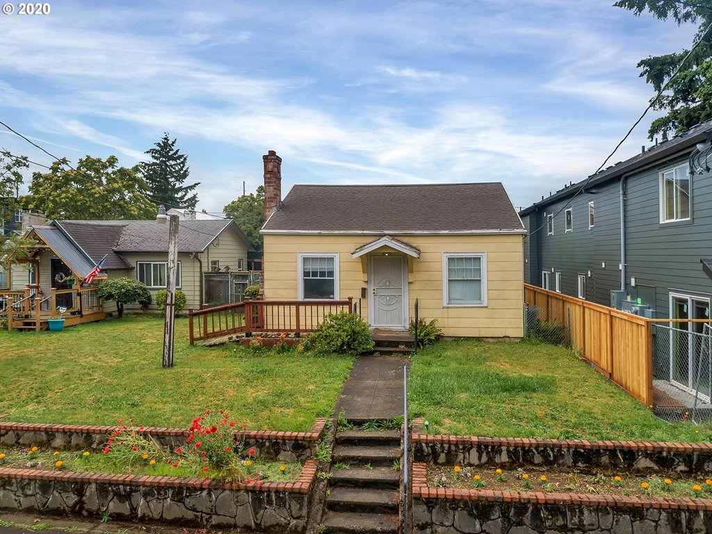 Bring your creativity and vision to make this classic PDX bungalow home! Located in primo Arbor Lodge close to Light Rail, New Seasons, Peninsula Park/Rose Garden, property includes these bonuses: antique woodstove, bike score:96, extra sq feet in the partial basement & a generous private yard with greenhouse, firewood and composter for gardens, pets & play. RM3 Zoning allows for development of multiple units (buyer to verify). Property sold as-is: seller to make no repairs. Dream. Tour.
