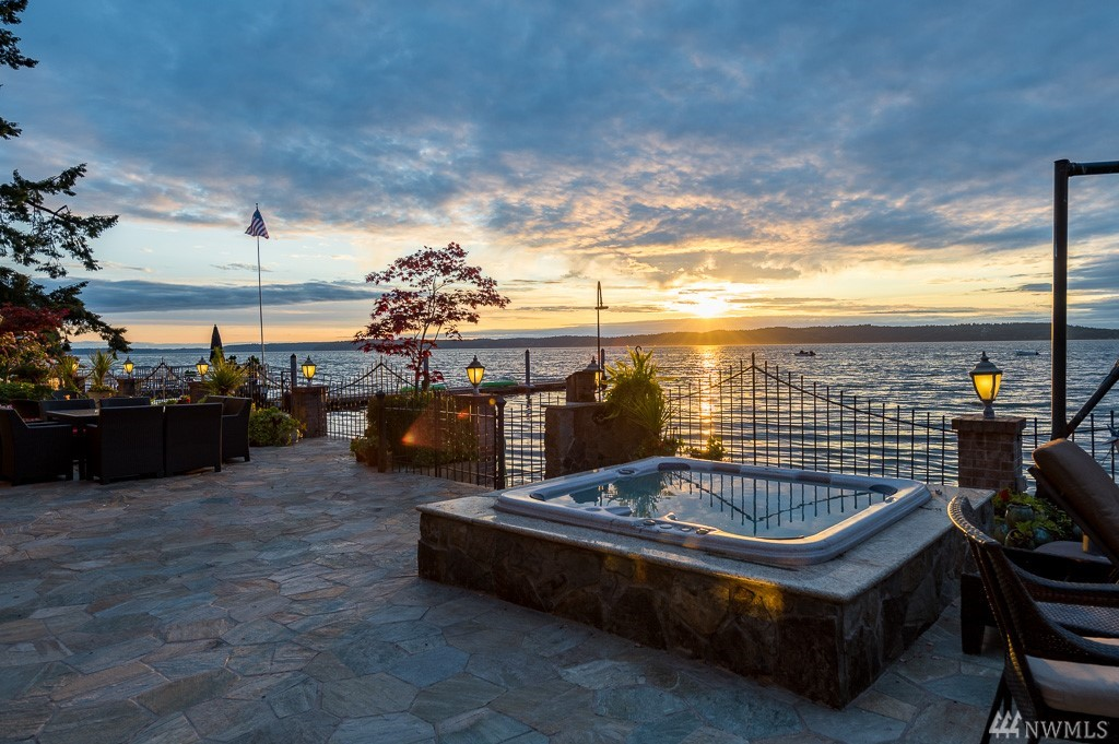 Your waterfront story begins here. Just 30 minutes to downtown SEATTLE, a private gated drive leads you to this remarkable oasis that sits perfectly on a private acre & 105 feet of sandy coveted Redondo Beach waterfront. An entertainer's dream and views from every room, this home boasts unsurpassed quality w/ the finest details & finishes. Stunning main floor master retreat, chef's kitchen, theatre, sport court, multiple garages w/ parking for 6 & RV parking. Unbelievable outdoor living spaces!