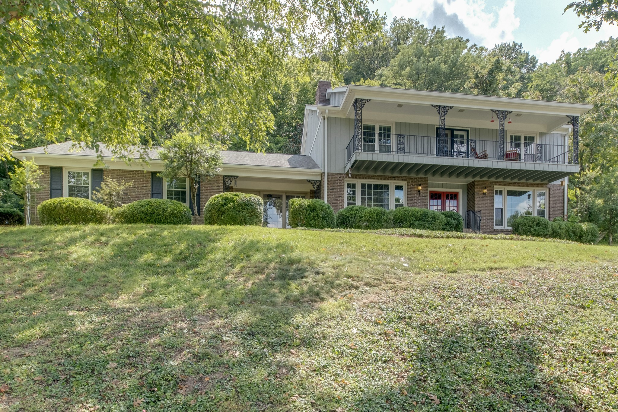 Treed cul-de-sac.Glorious Views. Fabulous granite gourmet kitchen w/wet bar.. Entertainers delight..Updated baths. Hrdwd floors. Ext. paint 2020. Vaulted Den w/ huge brick FP. Replaced windows. Living room makes great office. Full wall of closets in Primary BR. Major remodel 2015.  Upstairs landing useable space. Lovely patio area - country-like setting. Large grassy area in back. Relax on balcony. Irriga system. Near Radnor Lake. Convenient location/