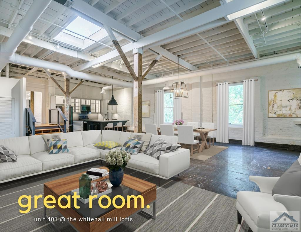 Combine high-value privacy, historic character, unique features and a highly desirable floor plan with the ability to call the South's oldest textile mill your new address, and you'll want this Whitehall Mill loft on your search short list. Unit 401 is one of the largest units in the mill, and offers some fantastic elements you won't find anywhere else. This two bedroom, two bathroom suite-based unit includes a private, shaded entrance, perfect for customizing into outdoor living space, and garden pathway. Inside, you'll find the perfect blend of industrial finishes, sliding barn doors, elements from the original 150-year-old mill and higher-end contemporary finishes. Skylights provide natural light, but you'll also love the window views in this condo, which are straight out into the treetops. The main space offers a soaring ceiling, original brick walls open concept living, with ample room for relaxing, a dining area and a fully updated kitchen, with upgraded, black stainless appliances, illuminated storage space and a large center island with seating. The first bedroom suite includes an original sliding metal door, walk-in-closet and refinished bathroom. The second suite includes a walk-in closet with shelving, an upgraded bathroom and a large sit-in area, which could easily become a third bedroom or office area. Both suites provide a tranquil and peaceful retreat away from the world. The overall feel of this unit is upgraded and offers an elegant and contemporary living space. With its complete 2017 renovation, all it needs is your personal touch to make it the perfect new space. The new owners also have the option of adding a large, wrap-around deck for even more outdoor living space. 401 is one of the quietest units in the complex, with only one shared wall and extra insulation. There's no question you can shut out the world and enjoy the best of condo living with this unit.  Whitehall Mills Lofts is an incredible space to call home, with a friendly community a