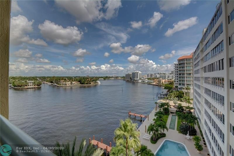 Experience true luxury & million dollar views as you step off your semi-private elevator & enter this expansive home through custom made wrought iron doors.  Experience intracoastal, downtown, & ocean views from one of your four balconies.  Over 4000 square feet of space including 3 spacious bedrooms plus an office, all with water views.  Oversized gourmet kitchen, formal dining room, sitting area & more. Marble floor thruout.  Electric shutters, new AC, new water heaters.   Enjoy privacy & security in this exclusive boutique building with only 24 units & 24 hour concierge. Building features covered parking with 2 spaces, a heated pool/spa and gym.  Just two blocks from the beach, minutes from Las Olas dining/shopping, & close to airport.  A rare opportunity to get this much space!