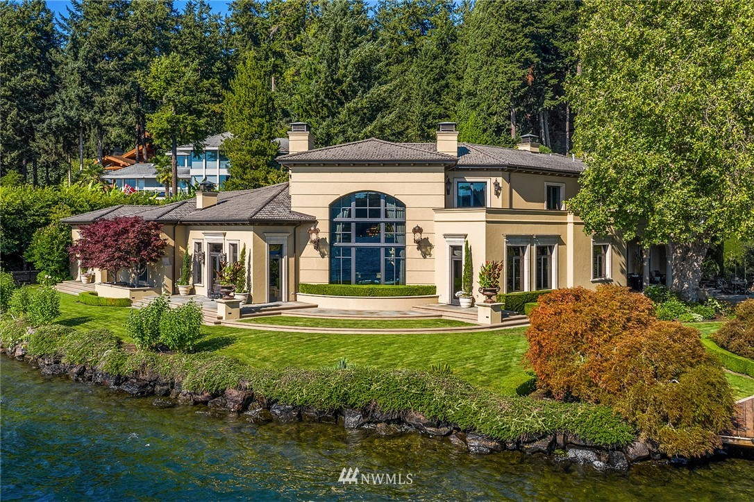 Château de Chêne // A Pinnacle of West Bellevue Waterfront. Occupying its own peninsula with 336ft of low-bank waterfront, and comprising a sublime Donald Whittaker designed Mediterranean residence of over 8,100sqft, this legacy property represents the finest expression of Pacific Northwest waterfront living. The home seamlessly interacts with its level park-like grounds and unobstructed water-level views from virtually every room, while providing enveloping luxury in its exquisitely detailed interiors. Extraordinary moorage make this the ultimate expression of gracious Northwest living.