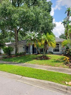 """CLOSE TO GULF BEACHES SHOPPING AND AIRPORT! You wont want to miss this spacious 3 bedroom 2 bathroom home nestled in a quiet neighborhood on a cul-de-sac street close to all that Sarasota has to offer. Through the breezeway and front door the BRAND NEW 24""""X24"""" PORCELAIN TILE FLOORS will be sure to catch your eye as you enter into the main living space of this home with a view straight through the rear sliding glass doors to the HUGE LANAI (28'x26') and beyond a tranquil pond view. The kitchen is in the center of the home just off the lanai making entertaining a breeze. The master is situated far left of the home for privacy with the guest rooms and guest bath to the right side. Open to the kitchen you will find a second living space large enough for a work from home or desk area and bar height counter seating at the kitchen. The new, mirrored Ikea storage cabinets are a bonus to the lucky buyer. The home also has a newer on demand tankless water heater, updated lighting and ceiling fans and updated guest bath. The master shower has been upgraded with a body spray unit and rain fall shower head. The master toilet includes a bidet seat, sure to please. There are three sets of sliders out onto the expansive paver lanai. In addition there is a small fenced area perfect for your furry friends.   The expansive lanai is just a huge blank canvas for you to get creative with furniture and decor to make your own.  You will love the layout of this home as well as its convenient location. Less than 6 miles to the closest beach. Nearby downtown Sarasota and the fabulous UTC Mall is just minutes away. Come live the Sarasota lifestyle, call today!"""