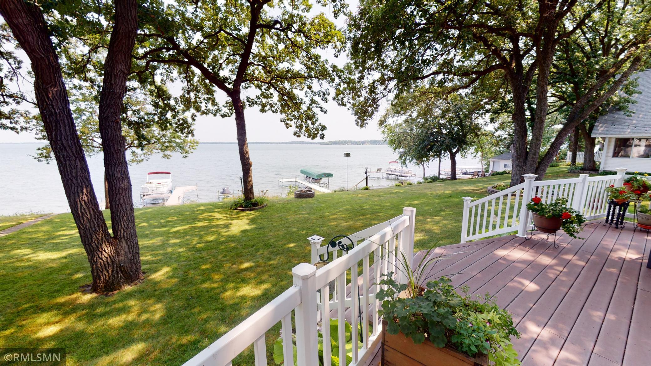 Make your lake home dreams a reality with this beautiful 4 bedroom, 3 bath home with 50 feet of amazing shoreline on Green Lake. Main level includes kitchen with breakfast area, formal dining area, gas fireplace in living room with wonderful lake views. Upper level features the master bedroom with walk-in closet and master bath, remaining 3 bedrooms, laundry, additional bathroom and office space with view overlooking the lake. Property also includes spacious back deck ready for entertaining, enjoying lake views and activities plus attached 2 stall garage.