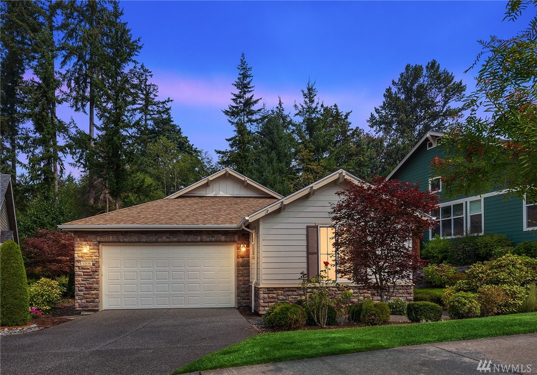 **NEW PRICE***  GORGEOUS (Vancouver Plan) 2 bed 1.75 spacious (1,930 sq.ft.) rambler in desirable 55+ Redmond Ridge Trilogy community. This COVETED floor plan provides Open Concept living with 10' tall ceilings, spacious great room floor plan w/formal living and dining spaces. Ultra private back deck on greenbelt. Truly the best of active 55+ resort living complete with miles of walking trails and amenities! *SELLER provided 2 YEAR Home Warranty! Welcome home!