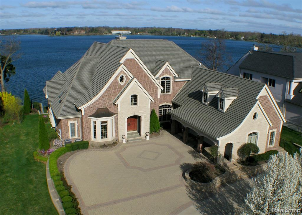 Spectacular Custom-Built  Lakefront Home on Prestigious Pine Lake with Breathtaking Lake Views, 100 Ft. Frontage, and Sunset Views. Amazing Custom Details Throughout featuring Grand Marble Foyer and Elegant Curved Staircase w/ Extravagant Ceiling Details and Beautiful Crown Molding. Huge 2-Story Great Room w/2-Way Fireplace & Wall of Windows. Designer Kitchen w/ Granite Custom Wood Cabinetry and Premium Appliances, Huge Island, Walk-In Pantry. 1st Floor Master w/ Marble FP,  Balcony, and Luxurious Marble Bath w/ Jacuzzi Tub, Marble Shower & His & Her Closets. Upper Level w/ 3 Large Bedrooms w/ Baths and Huge Bonus Room. Walkout LL features Heated Floors, Rec Room, Family Room, Exercise Room, Sauna. Home Theatre, Wet Bar, 2nd Full Kitchen, Bedroom & 2 Full Baths and Half Bath. Laundry Room on Each Level. Balconies and Multilevel Decks Overlook Lake and 3 Tiered Decks Walk Down To Lake. 3 Car Heated Garage. Some Exclusions. Listing Agent related to Seller. All M & D Approx.