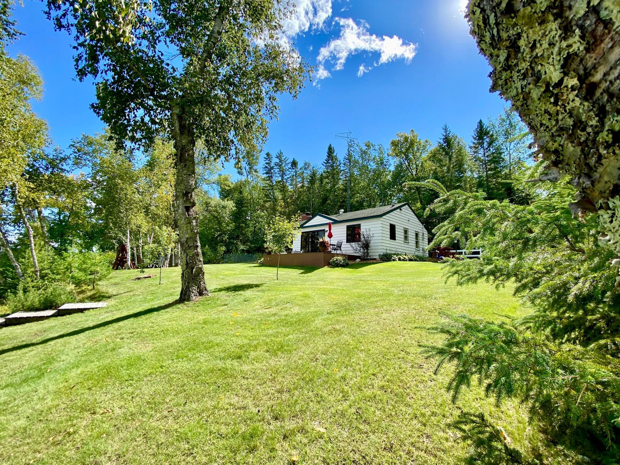Nestled on 2.56 wooded acres and 205 ft of sand shoreline, in the heart of the Chippewa National Forest sits this charming 2+ bedroom, 2 bath well-maintained year round home. Sand Lake, a beautiful 3,392 acre lake, connects to Bowstring Lake (9,528 acres) for miles of fishing and recreational fun. If you love fishing, this home is also just 7 miles from a boat landing on Cut Foot Sioux and Lake Winnie (18,904 acres). The lakes in this area have some of the best walleye fishing in the State of Minnesota. Close by are ATV and snowmobile trails for year round fun. This 1,757 sq ft home located on a quiet, dead end road has steel siding, trek deck, hardwood floors, knotty pine walls, fireplace for cool evenings and expansive windows for beautiful panoramic views. The wooded lot is very private and features a gradual slope to the shoreline.