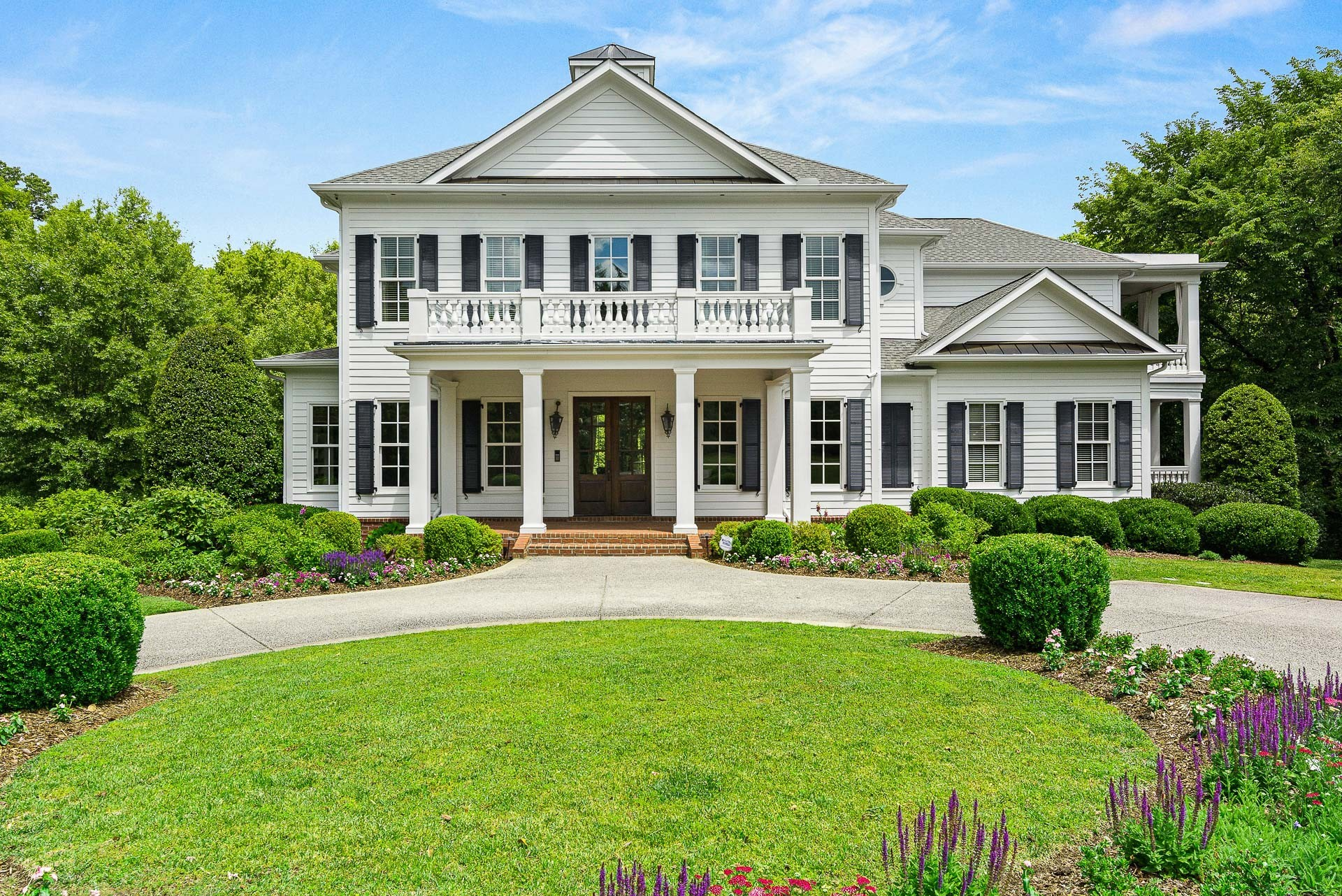 Exceptional Estate on private, wooded 3.38 acres in Brentwood. Southern Elegance with over 2,000 square feet of covered porches and terraces. Home overlooks beautiful private backyard with fenced  pool & play area. Several living areas include keeping room off the kitchen, great room and den all on the main level. Updated master bath, renovated entertaining area in basement level opening to large gathering are with fireplace, perfect for entertaining. 6 car tandem garage, and so much more!