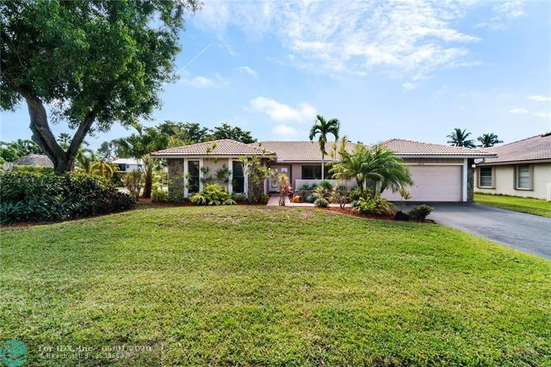 Updated home in highly desirable Cypress Run neighborhood of Coral Springs! Situated on a waterfront corner lot with impact windows & accordion shutters for hurricane protection. The kitchen features an eat-in area plenty of counter space.  Vaulted ceilings make this large house feel even larger! Tile & laminate wood flooring throughout the house – NO CARPET! 2nd bathroom has been beautifully updated with new vanity, new tile, & granite counter top! Oversized master bedroom features a large walk-in closet, his/hers vanities in the updated bathroom, and a walk-in shower. Master bathroom cabana door leads out to the private pool deck with tropical views. No HOA! Walking distance to Cypress Park, Cypress Water Park, & Orchid Park. Near shops, restaurants, great schools, and major highways!