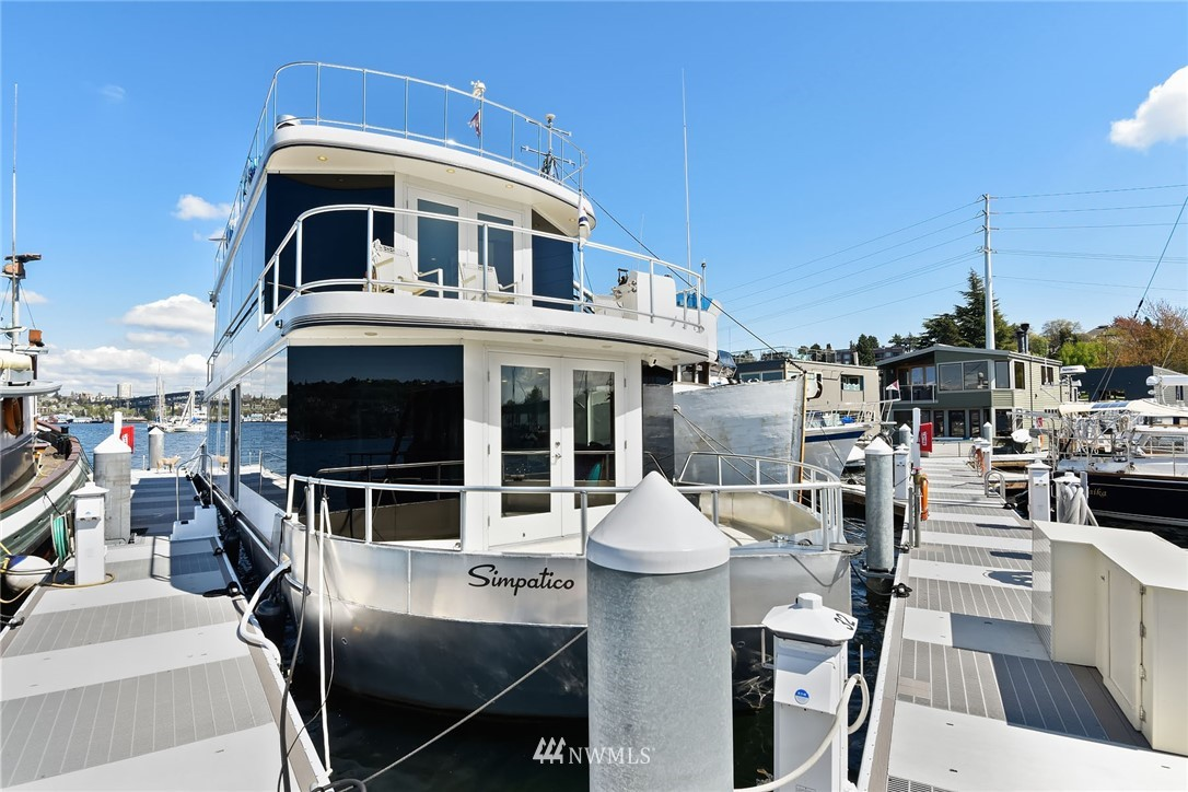 Attention to those seeking a unique experience: Desirable lakefront living on Lake Union! Own a rare 85' dock w/liveaboard permit & 65' houseboat. Rooftop deck w/360 degree views of the lake, Gasworks Park & city. Main floor features open kitchen overlooking living room w/gas fireplace; double doors opening to Lake Union. Main floor master w/full bath; walk-in closet; 2 bedrooms upstairs; TV room w/built-ins; wet bar; condo amenities with gated entry, secured garage parking & storage.