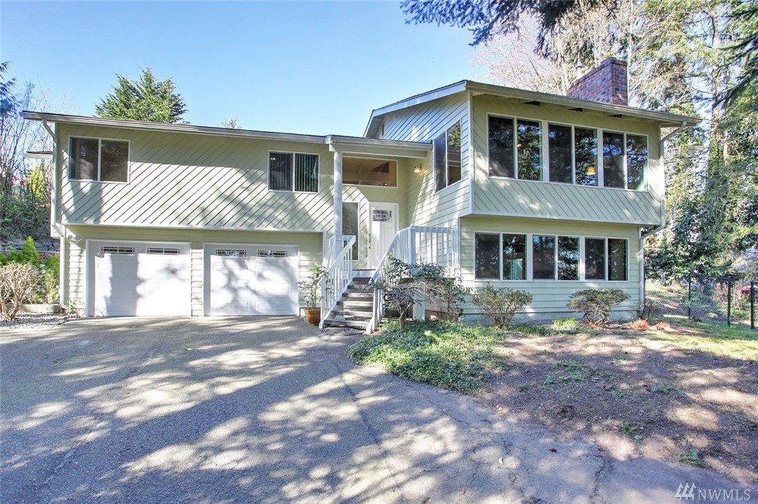 Warm & welcoming 4bd/3ba home on stunning acreage! Gated entry/secluded & magical setting w/incredible water feature & entertainment sized deck & patio. Chef's dream gourmet kitchen w/Miele+sub zero appliances. Enjoy walls of windows & skylights/gleaming hardwoods/newer carpet/open concept main living area. Master w/ensuite bath/walk-in closet & slider to deck w/view of waterfall. Immaculate! Lower floor features rec room+bedroom/.75 bath could be MIL suite. Just steps from Soos Creek Trail!