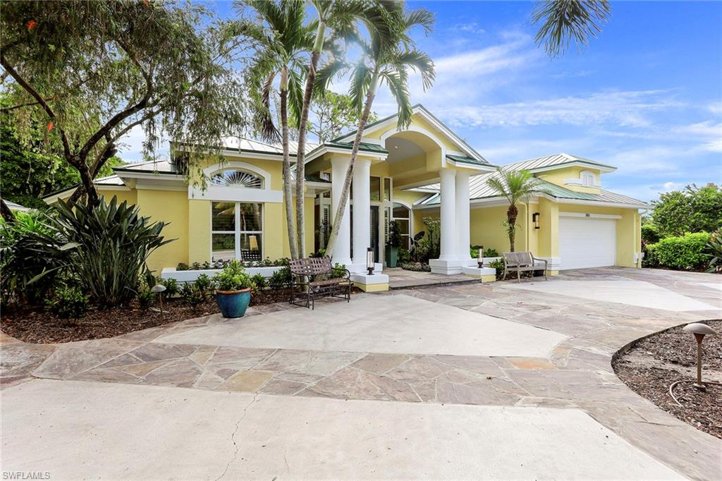 Welcome to Pine Ridge, ranked one of the best neighborhoods in the country. Nestled on a lush landscaped 1.2-acre lot. Enjoy picking fresh fruit from the variety of tropical fruit trees on the property. This exceptional home exudes Olde Florida charm, complete with the classic south Florida metal roof, plantation shutters, and a guest house. Enter into the gracious living/dining room. Appreciate the attention to detail and craftsmanship throughout the home, coffered ceilings, crown moldings, and hand-scraped wood floors. Flow into a Chefs dream gourmet kitchen, completely outfitted with Custom cabinetry and granite countertops, Wolf 6 burner range, Wolf microwave, Subzero refrigerator, ice maker, wine cooler, and Bosch dishwasher. Enjoy entertaining as family and friends gather around the large center island and spill into the expansive great room and pool area. Pine Ridge is located in a top school district, minutes from the beach, Artis-home of the Naples Philharmonic & Baker Museum, Waterside & Mercado for shopping, restaurants, and movie theaters. 15 minutes to Olde Naples 5th Ave south. Overflow of house guests? Two Ritz Carlton resorts are just a mile away.