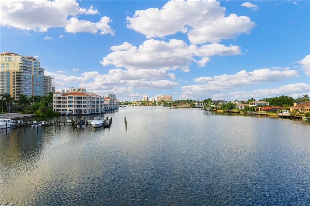 Spectacular Park Shore condominium with long water Bay and City views. Well-conceived and rarely available, this residence with highly sought-after exposure, large balcony and split bedroom floor plan is the ultimate in Park Shore living. End unit that is convenient to the celebrated shops and dining of The Village on Venetian Bay and a location which effortlessly permits travel to North or South Naples. Comes with deeded boat slip.
