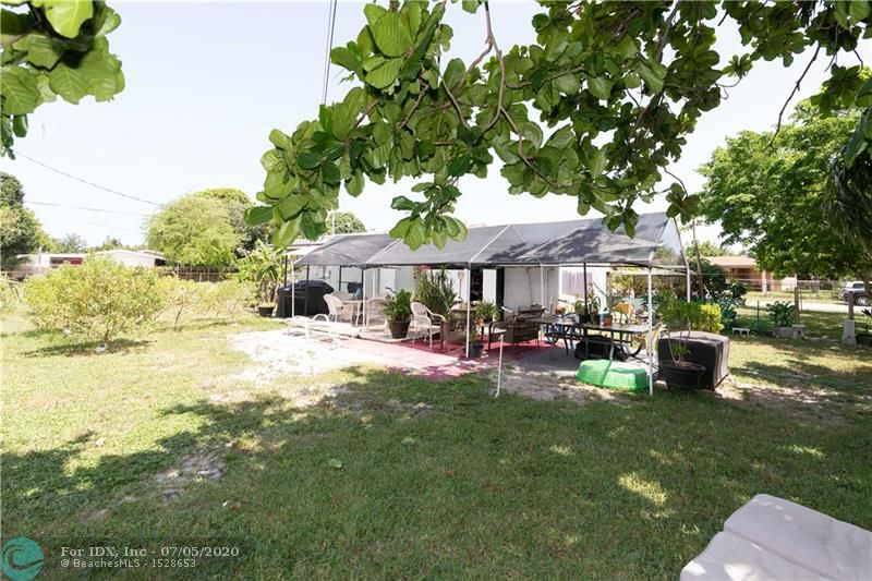 INVESTORS CHECK THIS OUT! Great price on this spacious and extremely clean and well maintained home.  1379 square feet of tiled flooring. Extra large master bedroom with private entrance.  Updated bath.  Updated kitchen with corian countertops and newer appliances. Large carport with separate laundry room. Extra large corner fenced yard, plenty of room for a pool-over 10,000 sq. ft. Roof 2005. Great location in this rapidly improving neighborhood, east of 95. Close to major highways, shopping, restaurants. Wilton Manors and downtown Fort Lauderdale and the beach are just minutes away..  TENANT OCCUPIED UNTIL 2/1/2021.  Contact listing agent for showings.