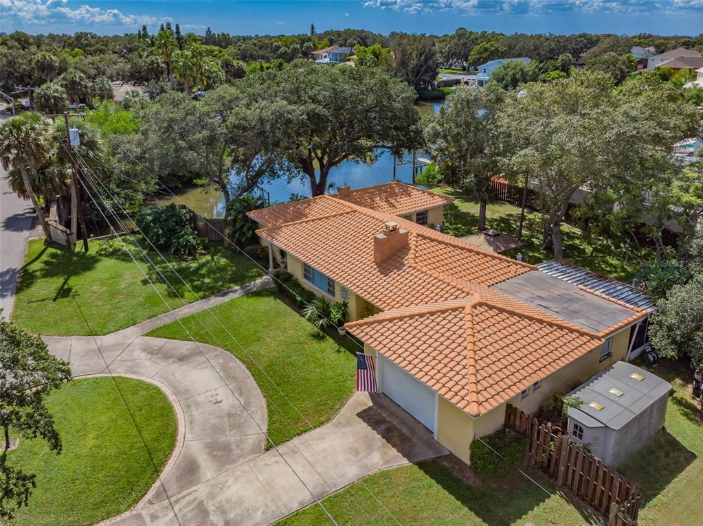 Look at this fabulous opportunity to own a slice of waterfront heaven in South Tampa! This 4 bedroom, 3 bath, corner lot block home is situated in the highly sought after neighborhood of Beach Park adorned with multi-million dollar homes. The lot has 128 feet of frontage on Shore Crest Dr and 81 feet on Azeele St. Located on Neptune Lagoon, you can jump into your boat and be in Tampa Bay in less than 5 minutes! The current floorplan has 3 bedrooms on the left side of the home and a 4th bedroom with en suite bathroom on the right side, behind the oversized 1 car garage.  A screened-in lanai sits behind this 4th bedroom. This space could be perfect for a multi-generational family. The tranquil corner lot allows for maximum privacy. Neptune Lagoon is known for the abundance of manatee that flock there year round and especially in the winter when they seek warmer water. The concrete roof is approximately 17 yrs new, HVAC and water heater are approximately 2 years new. Remodel the existing footprint to your specific design style or tear down and build your new home! Located just 10 minutes to Tampa International Airport, 40 minutes to the crystal blue waters of the Gulf Beaches. Bayshore Blvd/ Hyde Park Village is located just 15 minutes away where you will find all the trendy restaurants, shops and nightlife.