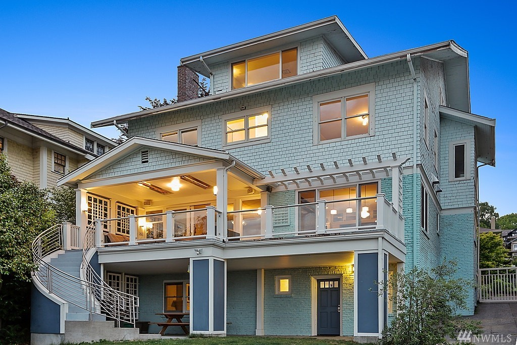 4-story/6040 sq ft, 1911 Queen Anne south slope Craftsman w/jaw-dropping, unobstructed views of Space Needle, downtown & Puget Sound. 4 bedrooms on same level, 3.25 baths, 9 ft ceilings, stylish new kitchen & great room, large home office, huge attic bonus room, mud/locker room, yoga room, electrical & plumbing updates, new water line, 2-car garage (w/220V for future electric car charger), fenced rear yard & tons of storage space. ADU potential. Original property owner: George & Angela Kinnear.