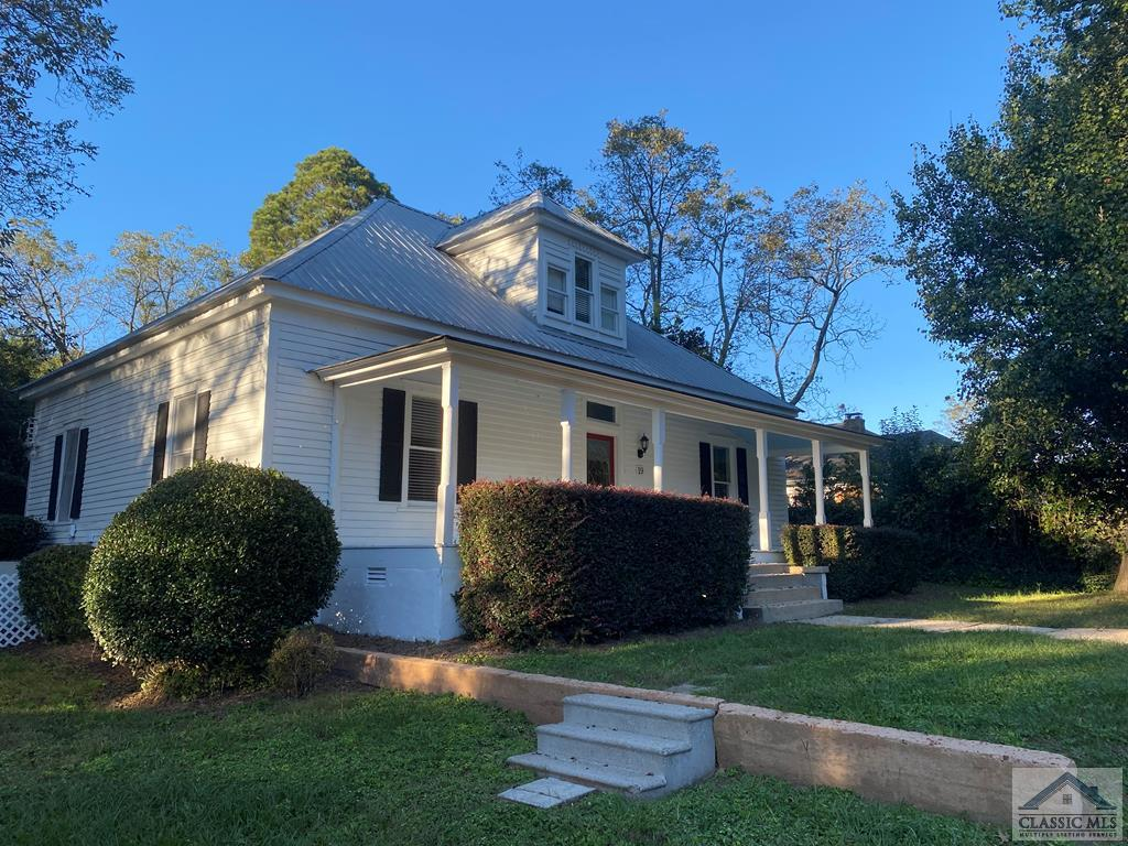 Located in desirable downtown Watkinsville! A rare find situated on one half acre lot built in 1915. When you step through the front door the foyer captures the feel of this historic home. The house has been updated but retained the character of the home with beautiful hardwood floors, original fireplaces & mantles, claw foot tub plus more!   The tin roof, large porch, wood burning stove, coal fireplaces, screen porch, pecan and eucalyptus trees are just a few of the features to enjoy.  It also features a fenced backyard area as well as plenty of additional unfenced back and side yard.  It is within walking distance to restaurants, coffee shop & shopping on main street and only 15 minutes from the University of Georgia campus. It has most recently been an AirBnB and comes completely furnished!  Owners are taking only a few personal items.