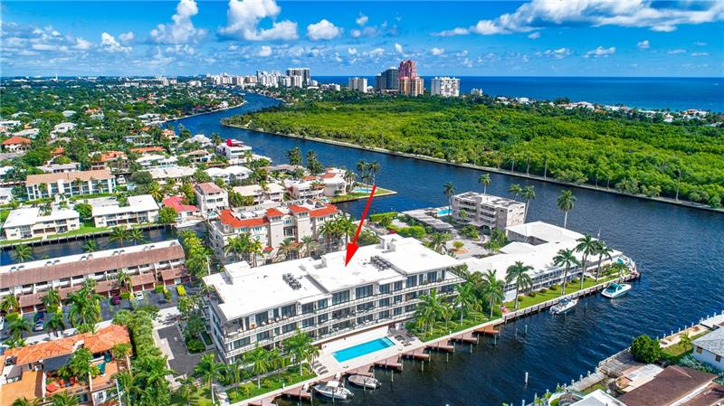 This rarely available unit is one of the only 15 at this exclusive boutique waterfront development in Coral Ridge. The residence features a private elevator, 10' ceilings with floor to ceiling windows, summer kitchen, flow through design, Italian cabinetry, two parking spaces, window treatments, Bosch appliances. Quartz countertops, kitchen island, terrace grill and light fixtures are all included. Porcelain flooring. Assigned dock for 28' boat. Aquarius is one lot off of the Intracoastal Waterway with Intracoastal and Birch State Park views. The beach, waterways, shopping, dining & entertainment are in proximity.