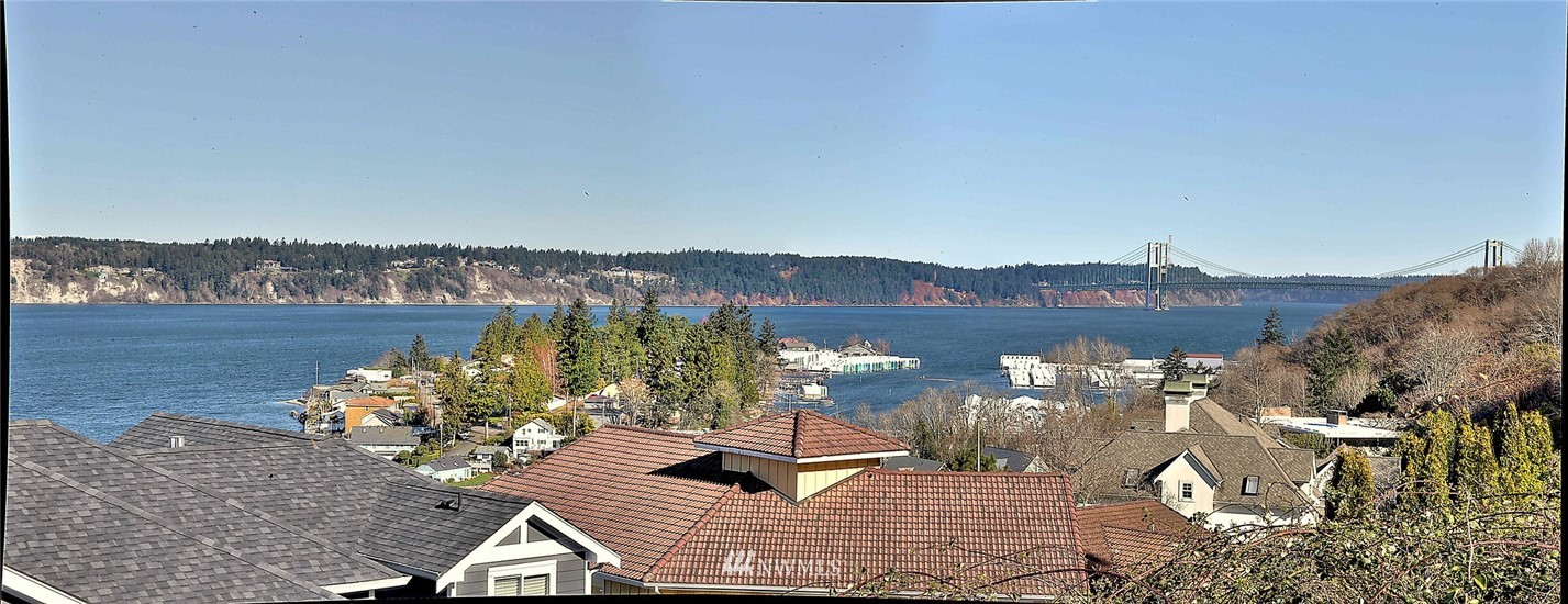 Stunning Western exposure with views of Puget Sound, Olympic Mtns, Fox Island and Narrows Bridge.  Rare find in University Place! .47 acre  with 2 bedroom, 2 bath manufactured home, large outbuilding and detached 3-car garage. Remove the manufactured home and build your dream home. If you have the vision the possibilities are endless!