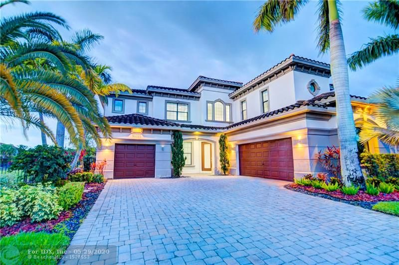 Best Deal To Live Luxurious Parkland Golf & Country Club Lifestyle! Popular Bolano Model w/Pool & Spa On Oversized Cul-de-Sac Waterfront Lot. Home Features 5 Bedrooms, 5.5 Bathrooms, Porcelain Tile Throughout Living Areas, Hardwood Floors In Bedrooms. White Kitchen w/Stainless Steel Appliances, Granite Countertops, Oversized Island Overlooks Large Breakfast Area & Built-In Bar. Family Room w/2-Story Height Ceilings, Guest Bedroom, On-Suite Bathroom Downstairs. Upstairs Master Suite w/Built-In Closets, Dual Vanity Sinks, Whirlpool Spa Tub, Large Glass Shower, & Private Terrace w/Views of Lake & Huge Fenced-In Yard. 24 Hour Guard Gated Community w/Resort Style Amenities, Optional Golf Membership, On-Site Restaurant, Kids Club, Splash Park, Playground, Tennis & Basketball Courts, A Schools!