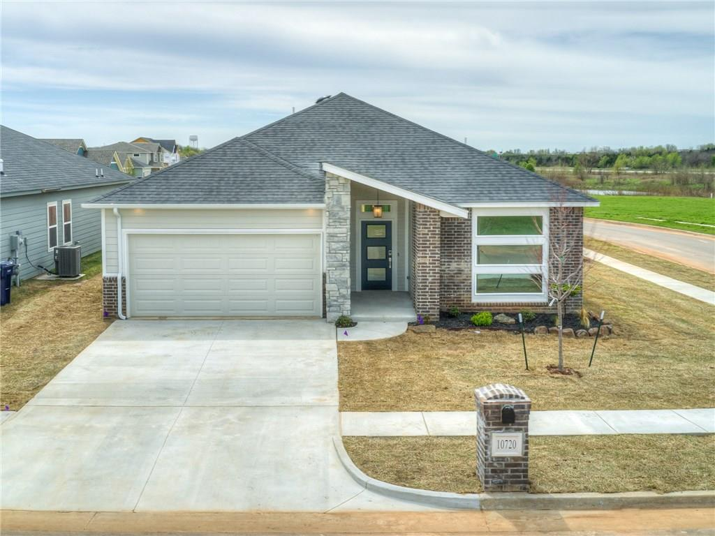 """The modern angles and innovative curb appeal given by the exterior is just a sample of the stylish interior that awaits.Enjoy the harmonious flow of a true """"open concept"""" floorplan.The living room, dining room & kitchen spaces were created to allow everything from easy entertaining to functional weeknights at home. The kitchen exhibits sleek contemporary cabinetry, fun accent tile & coveted large center island.The living room features a linear wall fireplace to compliment the clean design you feel throughout the home.In the master suite, you'll be delighted with the tile & glass shower, soaker tub, clean & spacious quartz vanities & tremendous closet. Important features always provided by this builder include eco-friendly materials & """"green"""" mechanical elements.The exterior is made up of James Hardie Fiber Cement Siding, which is a low maintenance product that does not contain wood. Builder is offering an entire year of lawn maintenance & housekeeping, call for details! Welcome Home!"""
