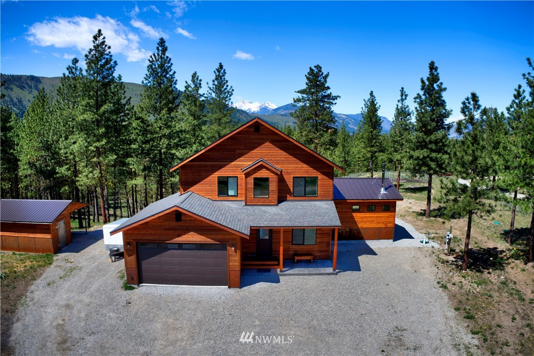 Beautiful newer home with stunning views of Mt. Gardner! So close to Winthrop plus you can leave your car at home with walkable access to the Methow Trail System. 3 bedrooms, 3 baths, den/TV room plus large living room, dining room & spacious kitchen. 9 foot ceilings. Hand crafted dining table & most furniture stays. Wood stove + propane fireplace. 3.58 acres with open views, tall trees and a fenced garden area. Large metal fire pit surrounded by hand crafted benches. Attached 2 car garage plus outbuilding with storage/shop space & carport.   Full RV hookup with 50 amp service, septic dump & water. Access to community pool, park & tennis courts.