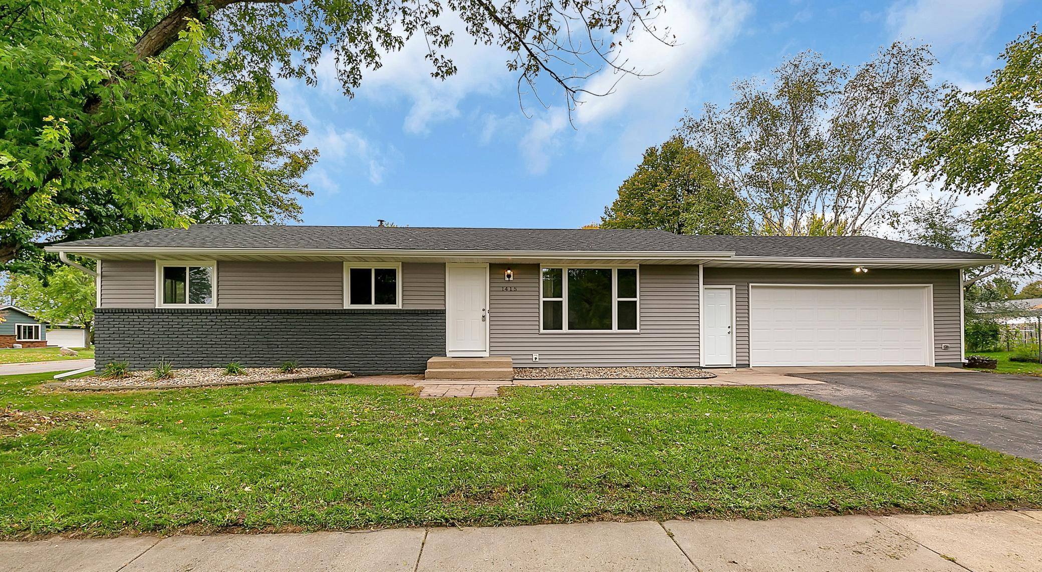 Opportunities like this do not come up very often: this large rambler in a great north side location sits on a corner lot with mature trees near North Jr. High and was significantly remodeled in 2018/2019 with all new siding, shingles, main floor windows, attic insulation, flooring, paint, kitchen cabinets and more. It also offers newer central air, updated egress windows, and a 24x24 ft fully sheetrocked garage. The main floor offers knockdown ceilings, plenty of large windows and has three bedrooms, a full bath with dual vanities and tile tub surround, a spacious living room and beautiful kitchen with dark stained poplar cabinets and stainless steel appliances. The basement has an enormous family room, fourth bedroom (with an easy spot to add a fifth bedroom if you desire), another bath and a finished laundry room with extra storage in the cedar closet. Enjoy all of these updates in a solid neighborhood convenient to HWY 15.