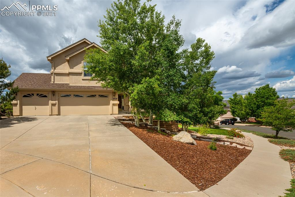 Remarkable 2-story home on .4 acre lot with mature landscaping and views of the mountains including Pikes Peak. The home is open, bright and roomy. The entry-way greats you with hardwood floors and grand views of the main level and upper level.  Large kitchen adjoins to the great room and showcases views of the mountains. Formal dining room and eat-in kitchen, vaulted ceilings in the great room and the master bedroom are just a few of the fabulous features.  There are fireplaces on the main level and in the basement.