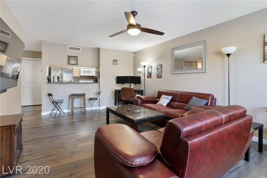 Gorgeous Luxury Living in the Las Vegas Country Club. Highly upgraded unit close to the strip but secluded in a guard gated oasis. Unique find, 2 bedrooms and 1 bath with a spacious floorplan. Kitchen has granite countertops and all appliances included. Highend flooring throughout and upgraded bathrooms. Cozy patio to enjoy those desert nights!! Community amenities include guard gated, security,pools, spas, golf course, parks, and exerise rooms and much much more...must see and easy to show!