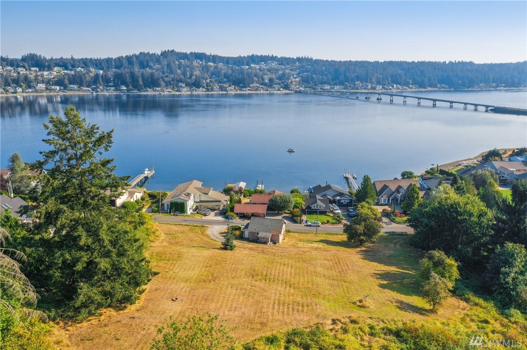 Don't miss this opportunity to build your dream home with gorgeous views! 3+ acres of land with spectacular views of Mt Rainier, Fox Island Bridge & Hales Pass. Great rental potential with a 1-bedroom cabin on site that includes a family room and full bath. 2 bedroom septic in place and a 2nd 4 bedroom drainfield installed, water/power to site.
