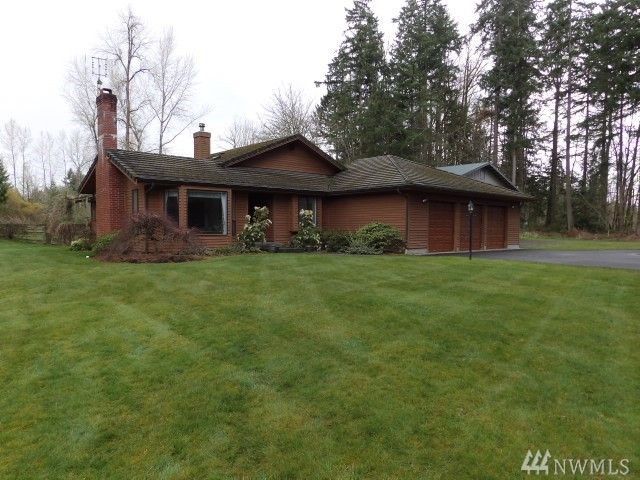 Solid Built Rambler on 6+ Level Acres with Custom SHOP located in the fast growing South Hill area of Puyallup. Extensive Hardwoods, Formal Living with Oversized Wood Burning Brick Fireplace, Formal Dining and Spacious Island Kitchen w/ Nook Boasts Tons of Cabinetry. Family Room w/ Wood Stove & French Doors out to the Custom Paver Patio. Spacious Master Suite w/ 5 Piece Bathroom and Walk-in Closet. Oversized 3 Car Garage plus 2 Bay Shop with a Lift! A little TLC will make this place shine again!
