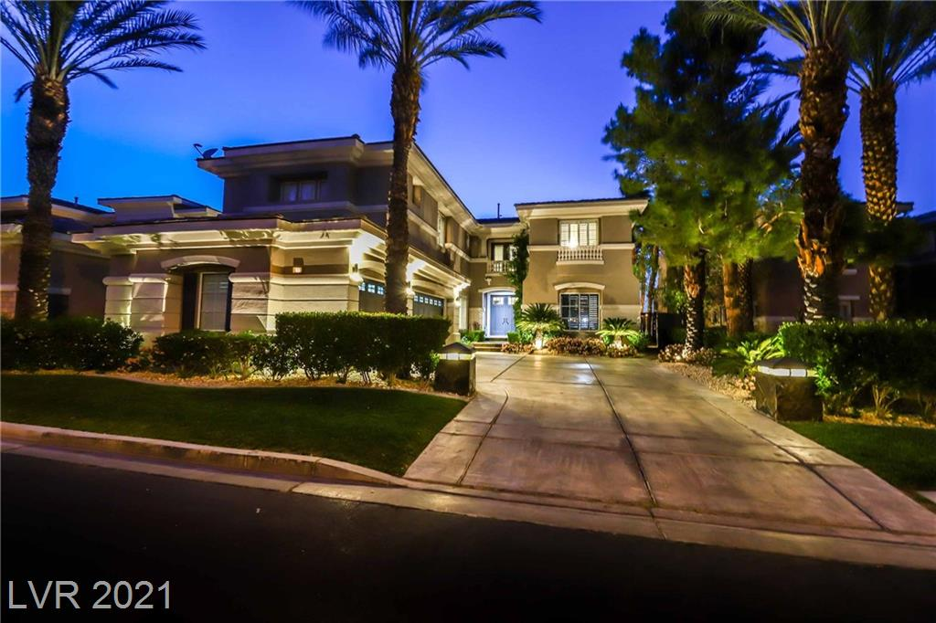 Stunning guard-gated home in Summerlin situated on the 9th fairway at TPC, with sweeping views of the course, and breathtaking mountain / sunset views. Remodeled Chef-style kitchen with bright white cabinets, and soft-close drawers, white quartz countertops, & high-end monogram luxury stainless appliances. Lavish temperature controlled wine room. Primary bath fully remodeled, w/ dual vanities/sinks, multi-head shower, and freestanding tub w/ a 2-way fireplace shared w/ the grand primary room w/ private balcony. This completely remodeled golf course home, great indoor / outdoor flow, with backyard oasis is ready for you to entertain your friends and family. Prime location minutes from shopping, dinning, downtown Summerlin, Red Rock, and much more! MUST SEE