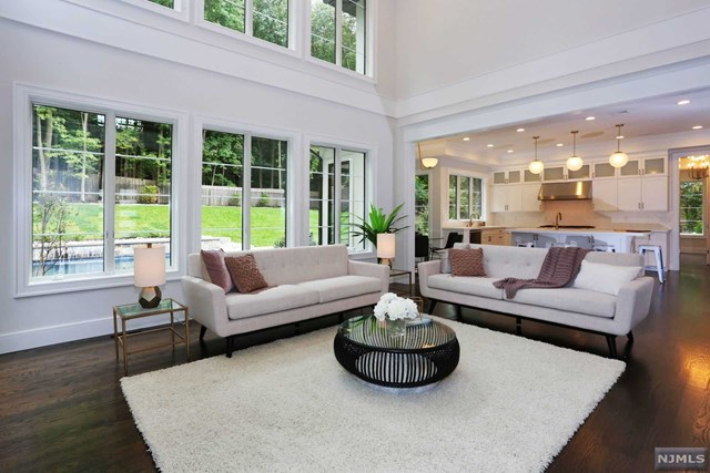 Tenafly E. Hill New Construction. Central Hall Colonial with 6 Bedrooms and 6.5 bathrooms situated on 0.51 Acre. HOUSE IS COMPLETE.  The first floor consists of 2 story Entrance Foyer open to formal Living Room & Formal Dining Room leading to huge Modern Eat-In Kitchen with SubZero & Wolf appliances, pantry room, butler pantry, over-sized island open to spacious 2 stories Great Room overlooking private backyard, Full Bath and Bedroom/Office on the first floor. A huge Mudroom connected to a 3 car heated garage. 2nd floor consists Master Bedroom Suite with his/hers Walk-in closets, 3 Bedroom suites, Laundry Room and Linen Closet. Lower level has a Bedroom,rec rm , gym, fb,Media rm . Seller holds a NJ Real Estate License. In-ground heated pool with waterfall.