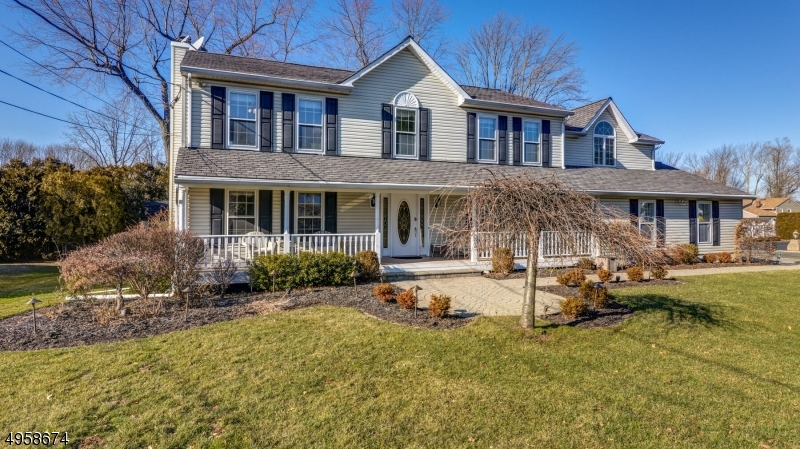A great house in a peaceful location!  Steps to town & train.  This colonial has amazing space.  The kitchen opens to the FR, with French doors to the deck.  Additional FR on 2nd fl, w/2 staircases to the second floor.  Master w/new bath, soaking tub, stall shower and walk in closet. Laundry can be found on the bedroom level or additionally one in the garage.  Exceptional basement with high ceilings perfect for a rec room or exercise area.  There is also a separate area that has endless storage.  Private rear yard with deck, hot tub, shed & outdoor lighting. Gas grill hookup on deck.  Heated garage.  All that & located close to NYC transportation, Newark Airport and Downtown Berkeley Hgts.  Be in to enjoy the summer!   VIRTUAL TOUR AVAILABLE, ASK YOUR AGENT OR ME!  HAPPY TO SHARE.