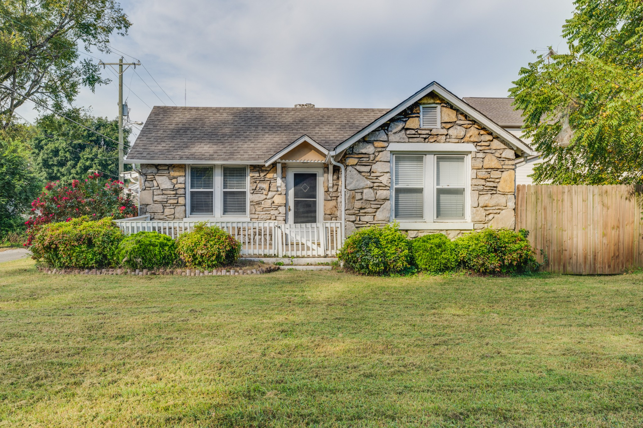 Charming stone cottage in the heart of Sylvan Park on a rare corner lot with alley access! Gorgeous original hardwoods and fireplace in a spacious living room. New plumbing mainline (2021), updated kitchen and bathroom with granite counters and Bosch appliances (2015), HVAC (2016), roof (2014), new side porch. Fenced in backyard and easy off-street parking. The investment opportunities are endless– renovate, rent, or build in one of Nashville's hottest neighborhoods.