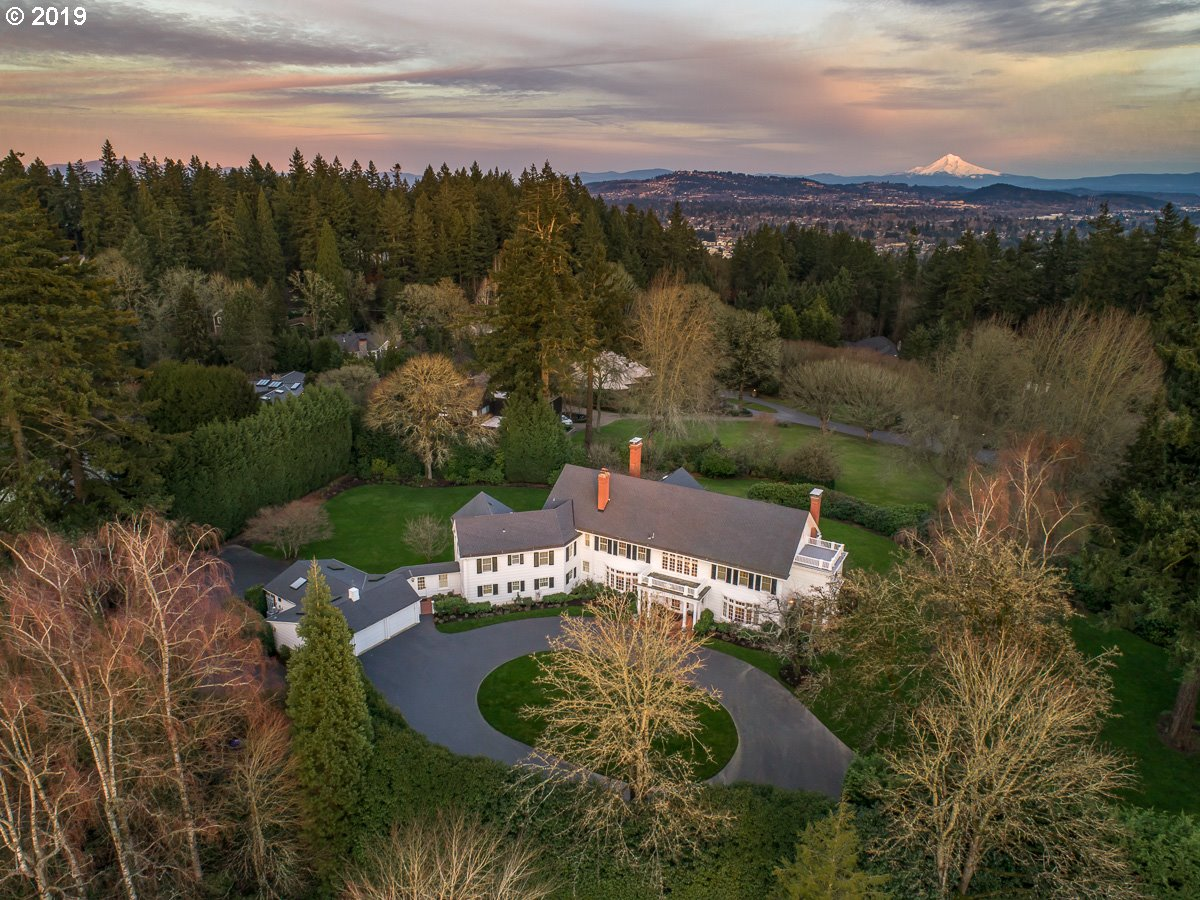 Iconic historical beauty located in the heart of Portland's esteemed Dunthorpe neighborhood on 1.5 acres. Circular drive & ample parking at this dream entertainer exuding the elegance & charm of yesteryear w/fully updated systems & infrastructure. Gated estate offers privacy and picturesque level sunny grounds with space for pool, tennis & more. Wonderfully set up for live-in/guests w/separate suite area. Handy location just minutes to downtown, Lake Oswego & more. Top-ranked Riverdale Schools.